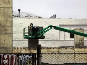 Man On Green Lift, © Iskra Johnson