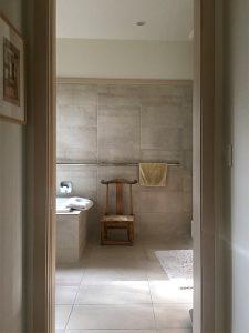 the bathroom as shrine, with chair
